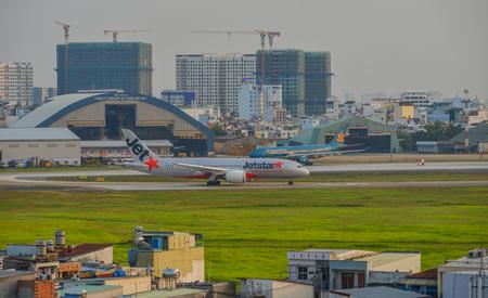Saigon, Vietnam - Mar 11, 2018. Aircrafts on runway at Tan Son Nhat Airport in Saigon (Ho Chi Minh City), Vietnam.