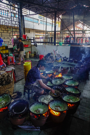 An Giang, Vietnam - Sep 2, 2017. A man cooking traditional meal in An Giang, Vietnam. An Giang is a province in southern Vietnam, bordering Cambodia.