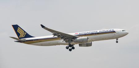 Saigon, Vietnam - Apr 15, 2018. A passenger airplane of Singapore Airlines landing at Tan Son Nhat Airport in Saigon (Ho Chi Minh City), Vietnam.