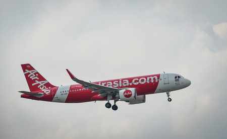 Saigon, Vietnam - Apr 15, 2018. A passenger airplane of AirAsia landing at Tan Son Nhat Airport in Saigon (Ho Chi Minh City), Vietnam. Stock Photo