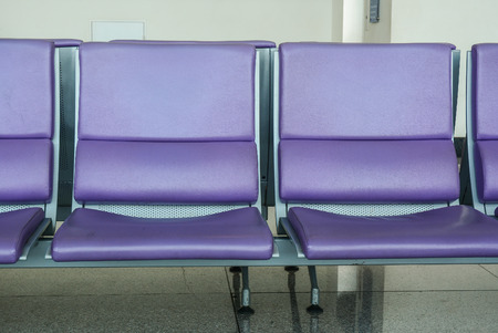 Waiting chairs at boarding gate of the airport.