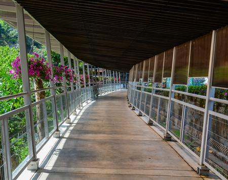 Penang, Malaysia - Mar 11, 2016. Wooden foot bridge in Penang, Malaysia. Penang Hill is a hill resort comprising a group of peaks on Penang Island.