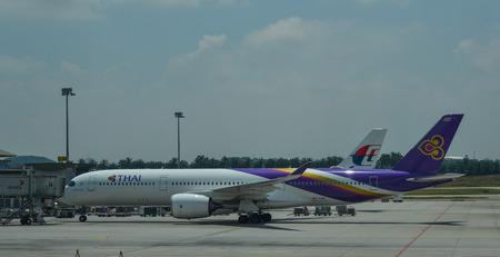 Kuala Lumpur, Malaysia - May 3, 2018. Passenger airplanes dock at Kuala Lumpur International Airport (KLIA-KUL).
