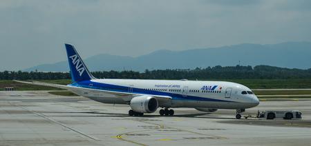 Kuala Lumpur, Malaysia - May 3, 2018. An ANA airplane on runway at Kuala Lumpur International Airport (KLIA-KUL). Редакционное