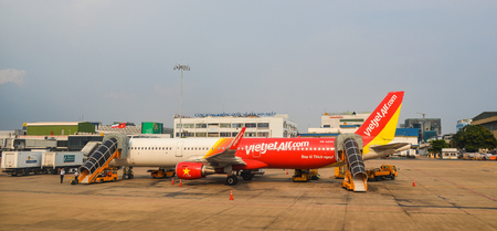 Ho Chi Minh City, Vietnam - Mar 9, 2016. Passenger airplanes docking at Tan Son Nhat Airport in Ho Chi Minh City (Saigon), Vietnam. Редакционное