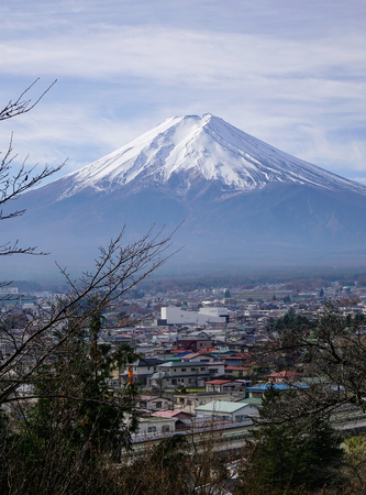 Mount Fuji with a township at sunny day in autumn.