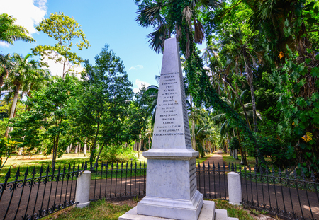 Port Louis, Mauritius - Jan 13, 2017. Stone monument at garden in Port Louis, Mauritius. Port Louis is the country economic, cultural and political centre.