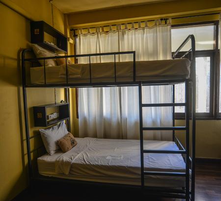 Bangkok, Thailand - Apr 22, 2017. Hostel dormitory beds at cheap room in Bangkok, Thailand.