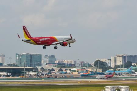 Saigon, Vietnam - Apr 15, 2018. A Vietjet airplane landing at Tan Son Nhat Airport (SGN) in Saigon (Ho Chi Minh City), Vietnam.