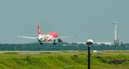 Kuala Lumpur, Malaysia - May 3, 2018. An Airbus A320 of AirAsia landing at Kuala Lumpur International Airport (KLIA).