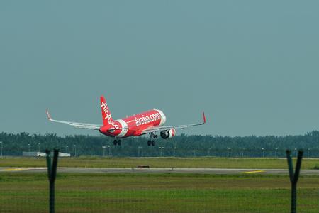 Kuala Lumpur, Malaysia - May 3, 2018. An Airbus A320 of AirAsia landing at Kuala Lumpur Airport (KLIA).