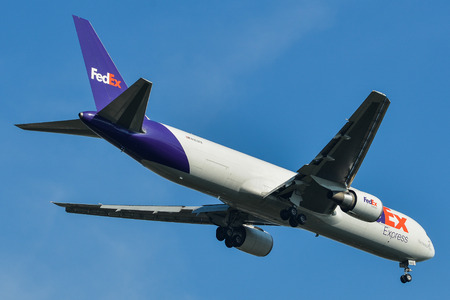Bangkok, Thailand - Apr 21, 2018. A Boeing 767 airplane of Federal Express (FedEx) landing at Suvarnabhumi Airport (BKK) in Bangkok, Thailand.