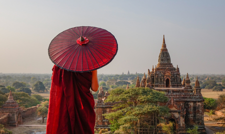 A young monk standing at Buddhist pagoda in Bagan, Myanmar. Reklamní fotografie
