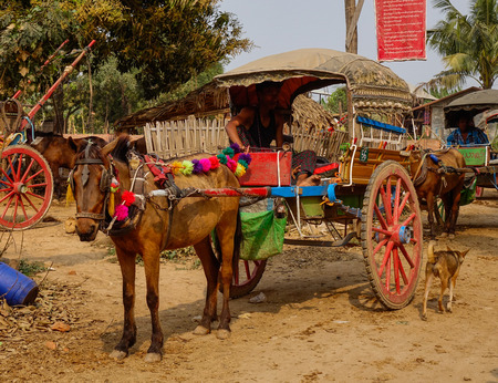 Bagan, Myanmar - Feb 22, 2016. Horse carts waiting for tourists in Bagan, Myanmar.