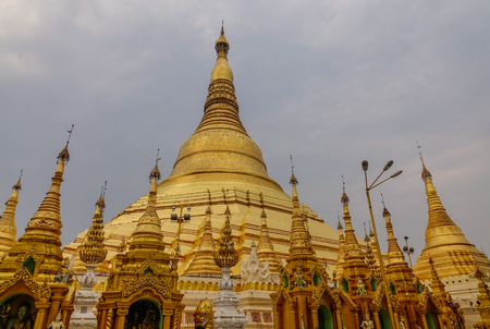 Golden stupas of Shwedagon Pagoda in Yangon, Myanmar. Shwedagon is known as the most sacred pagoda in Myanmar.