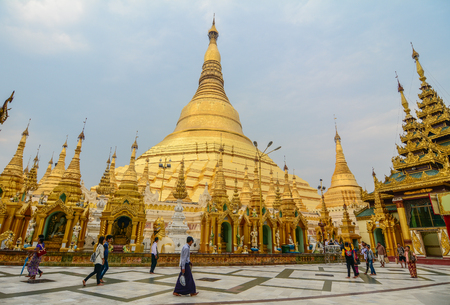 Yangon, Myanmar - Feb 26, 2016. People walking at Shwedagon Pagoda in Yangon, Myanmar. Shwedagon is known as the most sacred pagoda in Myanmar.