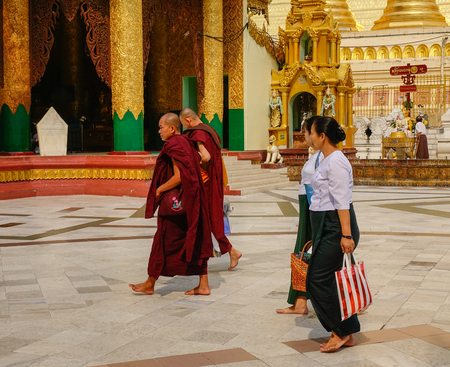 Yangon, Myanmar - Feb 26, 2016. Pilgrims at Shwedagon Pagoda in Yangon, Myanmar. Shwedagon is known as the most sacred pagoda in Myanmar.