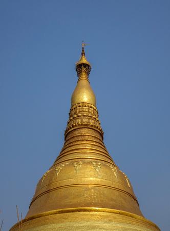 Top of main stupa at Shwedagon Pagoda in Yangon, Myanmar.