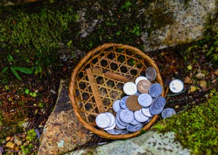 Praying coins at forest on Mount Koya (Koyasan) in Kansai, Japan. Stock Photo