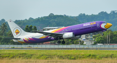 Phuket, Thailand - Apr 25, 2018. A Boeing 737-800 airplane of NokAir taking-off from Phuket International Airport (HKT). Editorial