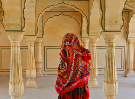 A young woman (travaler) visit ancient fort in Jaipur, India.