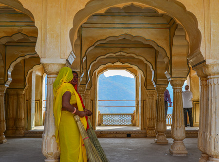 Jaipur, India - Nov 3, 2017. Indian women in saree working at Amber Fort in Jaipur, India.
