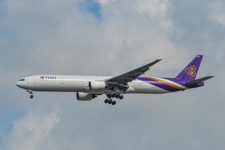 Bangkok, Thailand - Apr 21, 2018. A Boeing 777-300 airplane of Thai Airways landing at Bangkok Suvarnabhumi Airport (BKK).