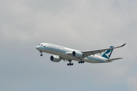 Bangkok, Thailand - Apr 21, 2018. An Airbus A350-900 airplane of Cathay Pacific landing at Bangkok Suvarnabhumi Airport (BKK).