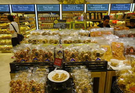 Bangkok, Thailand - Apr 21, 2018. People buying candies at supermarket in Bangkok, Thailand. Bangkok is the most populous city of the Kingdom of Thailand. Redactioneel
