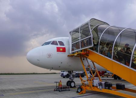 Dalat, Vietnam - Apr 17, 2018. A passenger airplane of Vietjet Air docking at Lien Khuong Airport (DLI) in Dalat, Vietnam. Sajtókép