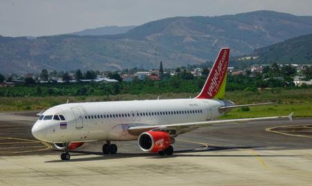 Dalat, Vietnam - Apr 17, 2018. A passenger airplane of Vietjet Air docking running on runway of Lien Khuong Airport (DLI) in Dalat, Vietnam.