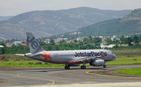 Dalat, Vietnam - Apr 17, 2018. A passenger airplane of Jetstar Pacific running on runway of Lien Khuong Airport (DLI) in Dalat, Vietnam.