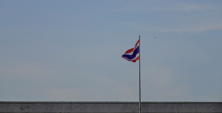 National flag of Thailand on a building in Bangkok, Thailand. Stock Photo - 104155594