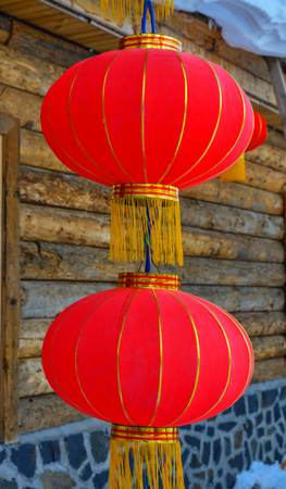 Hanging red lantern at wooden house in Harbin, China. Foto de archivo