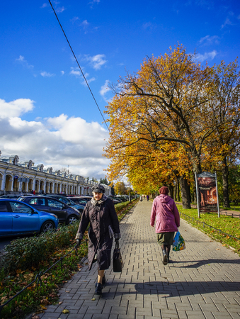 St Petersburg, Russia - Oct 7, 2016. People walking on street in Saint Petersburg, Russia. Saint Petersburg has a significant historical and cultural heritage.