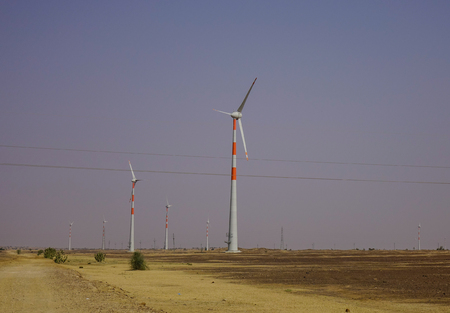 Wind turbine in Thar desert near Jaisalmer, Rajasthan, India. Stock Photo