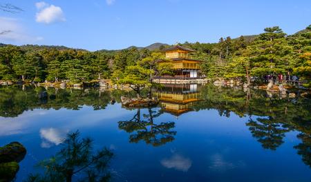 Kinkaku-ji Temple in Kyoto, Japan. The Golden Pavilion (Kinkaku) is a three-story building on the grounds of the Rokuon-ji temple complex.