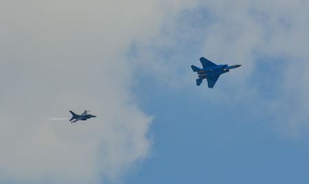 Singapore - Feb 10, 2018. Fighter aircarft team (F-15SG & F-16C) flying on display near Changi Air Base, Singapore.