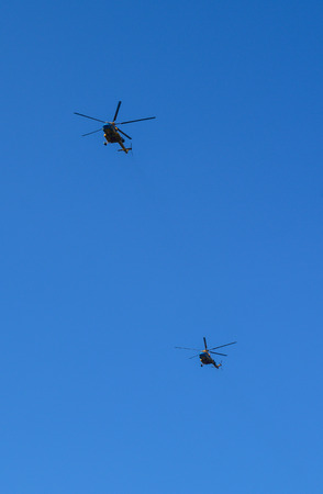 Helicopters flying in the blue sky in Nha Trang, Vietnam.