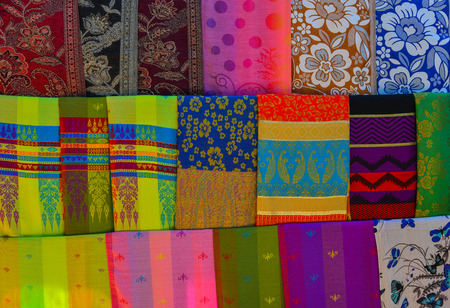 Colorful textile for sale at street market in Mandalay, Myanmar. 版權商用圖片 - 104521442