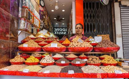 Delhi, India - Jul 27, 2015. Selling nuts at street market in Delhi, India. Delhi city proper population was over 11 million, the second-highest in India. Editorial