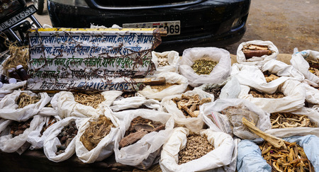 Delhi, India - Jul 27, 2015. Selling dried herbal at street market in Delhi, India. Delhi city proper population was over 11 million, the second-highest in India.