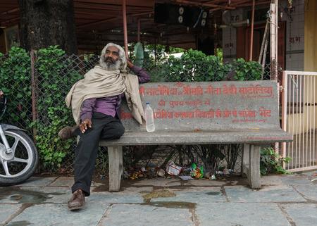 Delhi, India - Jul 27, 2015. A homeless man on the street in Delhi, India. Delhi city proper population was over 11 million, the second-highest in India.