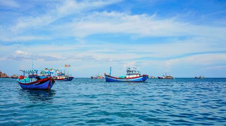 Wooden fishing boat docking on blue sea in Quy Nhon, Vietnam.