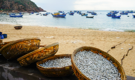 Drying fish in bamboo basket on the beach in Quy Nhon, Vietnam.