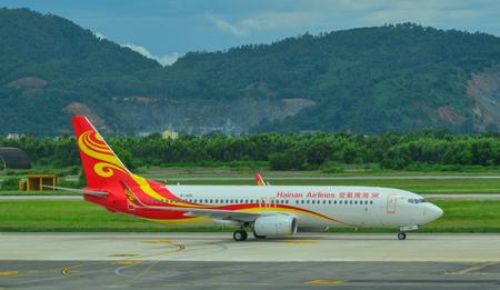 Da Nang, Vietnam - Jul 23, 2018. A Boeing 737-800 airplane of Hainan Airlines taxiing on runway of Da Nang International Airport (DAD).