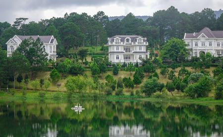 Dalat, Vietnam - Aug 17, 2017. Private villas with the lake in Dalat, Vietnam. Da Lat is a popular tourist destination, located 1500m above sea level. Sajtókép