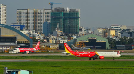 Saigon, Vietnam - Jul 26, 2018. Passenger airplanes taxiing on runway at Tan Son Nhat Airport (SGN) in Saigon (Ho Chi Minh City), Vietnam.
