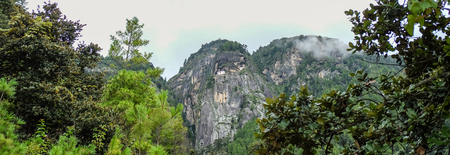 Mountain scenery with deep forest and Paro Taktsang Monastery (Tiger Nest) background in Paro, Bhutan.