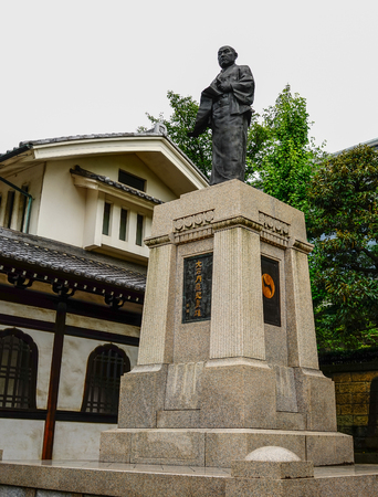 Tokyo, Japan - Jul 18, 2015. Statue of Oishi Kuranosuke, the leader of 47 loyal ronin, one of the most popular Japanese historical stories at Sengakuji Temple.